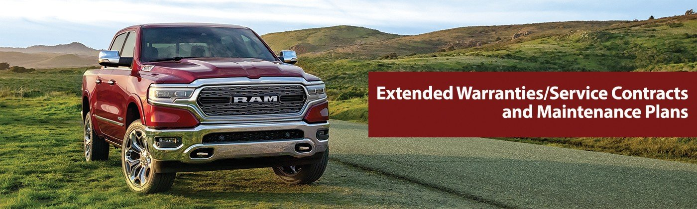2019 1500 Limited in Delmonico Red parked on grass alongside road through hilly countryside.